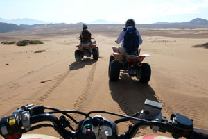 Quad biking in the dunes above the Kunene River, Serra Cafema